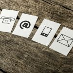Communication icons: telephone, email, mobile, post