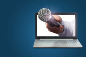 A microphone extending from a laptop screen.