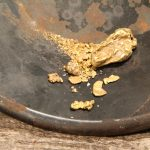 real california gold nuggets in a gold pan