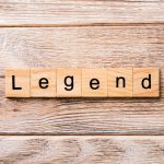 Wooden Scrabble-style blocks spelling the word legend